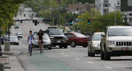 Francisco Kjolseth     The Salt Lake Tribune Bicyclists make their way through downtown traffic in downtown Salt Lake City. A new report by the League of American Bicyclists ranks Utah 13th in the nation for friendliness toward cyclists.