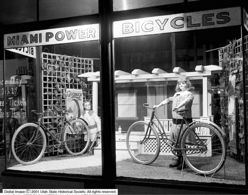 Image shows the Meredith Motor and Bicycle Company display windows at night February 28, 1916. Courtesy of Utah Historical Society
