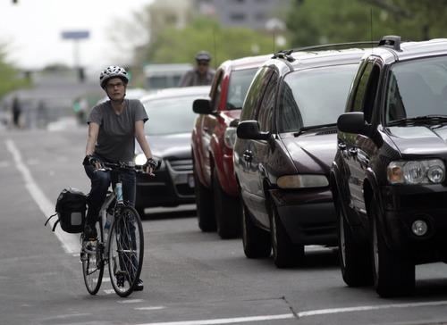 Kim Raff   The Salt Lake Tribune A person rides a bicycle down 200 South in downtown Salt Lake City, Utah on April 30, 2012.