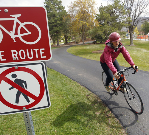 Al Hartmann     The Salt Lake Tribune Heidi Goedhart, the University of Utah's Bicycle Coordinator Intern rides on one of the designated bicycle trails through campus south of the Olpin Union Building.     The school is unveiling its new Bicycle Master Plan as part of its Earth Day festivities.