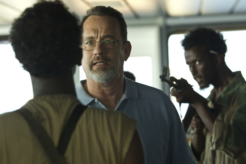 """Tom Hanks portrays Capt. Richard Phillips, whose cargo ship is boarded by Somali pirates, in the drama """"Captain Phillips."""" Hopper Stone 