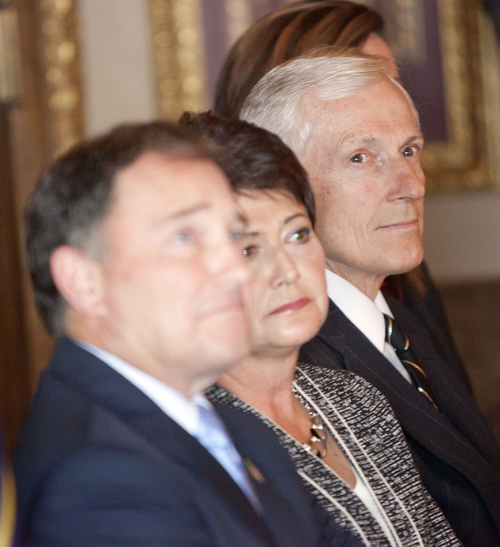Keith Johnson | The Salt Lake Tribune   Utah Lt. Gov. Greg Bell, right, along with Utah Gov. Gary Herbert and his wife Jeanette, listen to Rep. Spencer J. Cox, R, Fairview speak after Gov. Herbert announced Cox nomination for Lt. Governor, October 8, 2013 in Salt Lake City. Lt. Gov. Bell is resigning after holding the office since 2009.