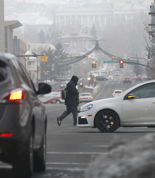 Al Hartmann  |  The Salt Lake Tribune Commuters go to work in downtown Salt Lake City on Feb. 5, 2013, on a foggy morning with another unhealthy air day for sensitive groups in the forecast.
