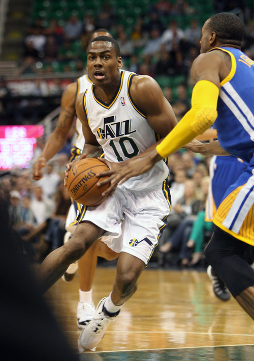 Steve Griffin  |  The Salt Lake Tribune  Utah's Alec Burks drives drives into the lane during first half action in the Jazz versus Golden State preseason NBA basketball game at the EnergySolutions Arena in Salt Lake City, Utah Tuesday, October 8, 2013.