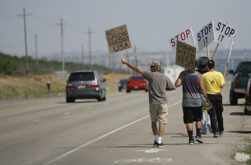 Francisco Kjolseth  |  The Salt Lake Tribune Opponents of the NSA Data Center protest the center on the 4th of July along Redwood road near the entrance to the new facility