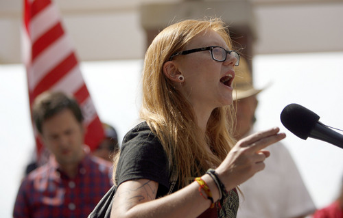 "Francisco Kjolseth  |  The Salt Lake Tribune Activist Macey Booth of Salt Lake speaks out ""you are using the First amendment to speak out and say you want your 4th amendment back!"" while joining opponents of the NSA Data Center during a peaceful protest on the 4th of July near the new facility along Redwood road."