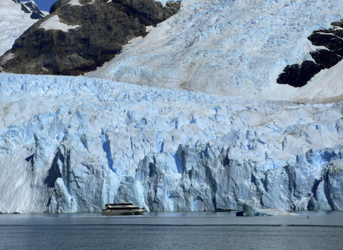 FILE - This Wednesday, Feb. 23, 2011 file photo shows a tour boat as it passes near the snout of Spegazzini Glacier in Los Glaciares National Park in Argentina. There are dozens of glaciers in the area fed by the Southern Patagonian Ice Field, which blankets a wide swath of the Andes between Chile and Argentina. Just how to define a glacier is at the heart of a Chilean congressional battle that could determine the future of mining in the worldís largest copper-producing country. (AP Photo/Ian James, File)