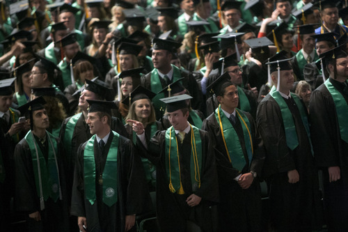File photo   Chris Detrick     The Salt Lake Tribune Utah Valley University valedictorians stand during the Commencement exercises at the UCCU Events Center Thursday April 25, 2013. Gov. Gary Herbert wants 66 percent of Utahns to have some post-secondary education by 2020.