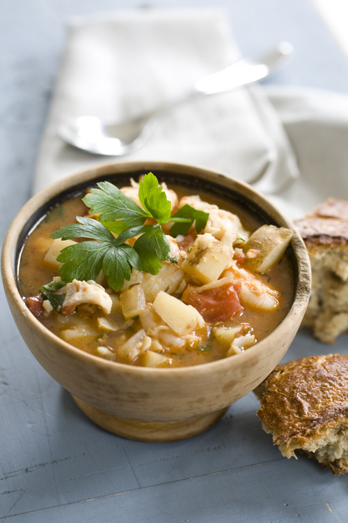 This spicy shrimp and haddock stew is every bit as rich and flavorful as a good chili or meat-based stew, but cooks up in no time. Unlike beef, which needs a long, low simmer to become tender, seafood prefers to be cooked quickly, otherwise it can toughen up.  (AP Photo/Matthew Mead)
