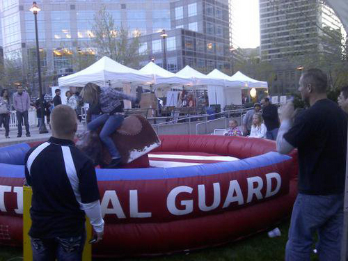 In this photo from the Utah National Guard's Facebook page, a patron rides one of the Guard's mechanical bulls at a 2010 event.