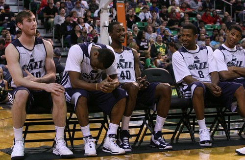 From left: Gordon Hayward, Alec Burks, Jeremy Evans and Dominic McGuire share a laugh during player introductions. Utah Jazz fans filled EnergySolutions Arena to get a glimpse at this year's players during the annual scrimmage Saturday, Oct. 5, 2013. The Jazz roster currently includes 20 players, but NBA rules require that that number must be reduced to 15 by opening night, Oct. 30 against Oklahoma City. (AP Photo/The Salt Lake Tribune, Leah Hogsten)