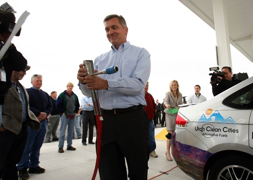 Leah Hogsten     The Salt Lake Tribune Utah Congressman Jim Matheson replaces the natural gas fuel pump after refueling a NGV with the help of the car's owner during a press conference in April, 2011, to promote legislation that would give tax credits and incentives to NGV production and refueling stations.
