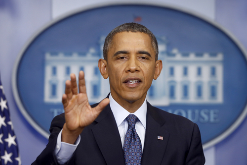 """President Barack Obama speaks about the the budget and the partial government shutdown, Tuesday, Oct. 8, 2013, in the Brady Press Room of the White House in Washington. The president said he told House Speaker John Boehner he's willing to negotiate with Republicans on their priorities, but not under the threat of """"economic chaos.""""   (AP Photo/Charles Dharapak)"""