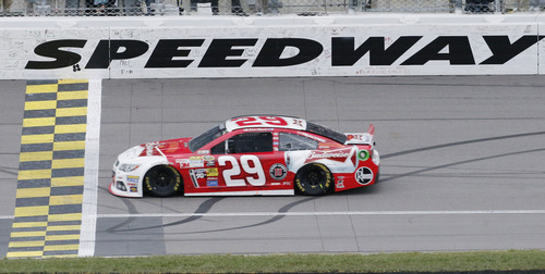 Driver Kevin Harvick (29) crosses the finish line to win the NASCAR Sprint Cup series auto race at Kansas Speedway in Kansas City, Kan., Sunday, Oct. 6, 2013.  (AP Photo/Orlin Wagner)