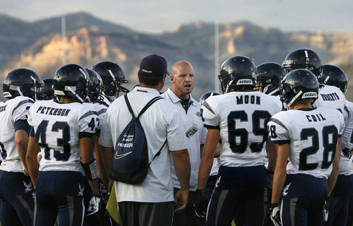 Scott Sommerdorf   |  The Salt Lake Tribune Duchesne head coach Jerry Cowan talks with his team after pre-game drills. The Eagles would go on to an easy 35-0 win against Carbon High which ran their winning streak to 37 games, setting the Utah state record for consecutive wins, Friday, September 6, 2013.
