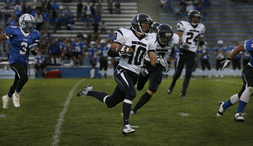 Scott Sommerdorf   |  The Salt Lake Tribune Duchesne RB Matt Muir runs the ball for Duchesne during their 35-0 win over Carbon High that gave them their 37th win in a row and set the Utah state record for consecutive wins.