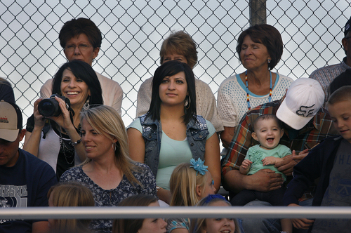Scott Sommerdorf   |  The Salt Lake Tribune Elaine Despain, left, watches her son, Dylan Despain, play for Duchesne alongside daughter Emily James, center, and her husband Levi James, right,  who is holding baby Kennedy James in the visitor's bleachers at Carbon High in Price, Friday, September 6, 2013. Dylan Despain's five older brothers have played for Duchesne High. Duchesne beat Carbon 35-0 for their 37th win in a row and set the Utah state record for consecutive wins.