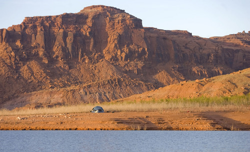 Al Hartmann  |  Tribune file photo  There's plenty of elbow room for tent camping on sandy beach in Good Hope Bay on Lake Powell.