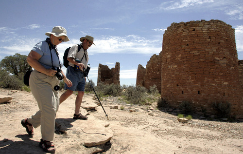 |  Tribune file photo  Wendy and Scott Henderson of Livermore California tour the historic ruins of a pueblo people at Hovenweep National Monument in southern Utah.
