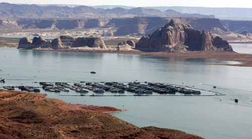 |  Tribune file photo  Boaters are dwarfed by the sandstone walls of Lake Powell.