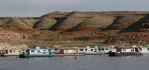 Francisco Kjolseth  |  Tribune file photo  House boats sit idle near Bull Frog marina on Lake Powell.