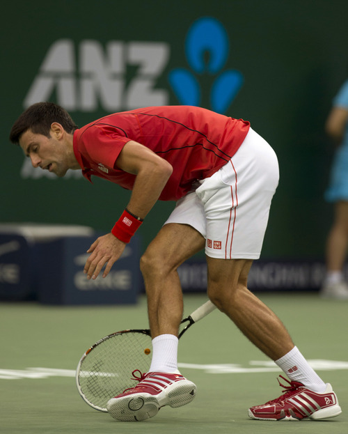 Serbia's Novak Djokovic trips during a match against Spain's Marcel Granollers for the Shanghai Masters tennis tournament at the Qizhong Forest Sports City Tennis Center in Shanghai, China, Wednesday, Oct. 9, 2013. Djokovic won 6-2, 6-0. (AP Photo/Ng Han Guan)