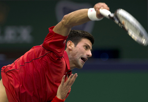 Serbia's Novak Djokovic serves during a match against Spain's Marcel Granollers at the Shanghai Masters tennis tournament at the Qizhong Forest Sports City Tennis Center in  Shanghai, China, Wednesday, Oct. 9, 2013. Djokovic won 6-2, 6-0. (AP Photo/Ng Han Guan)