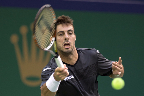 Spain's Marcel Granollers returns the ball during a match against Serbia's Novak Djokovic for the Shanghai Masters tennis tournament at the Qizhong Forest Sports City Tennis Center in Shanghai, China, Wednesday, Oct. 9, 2013. Djokovic won 6-2, 6-0. (AP Photo/Ng Han Guan)