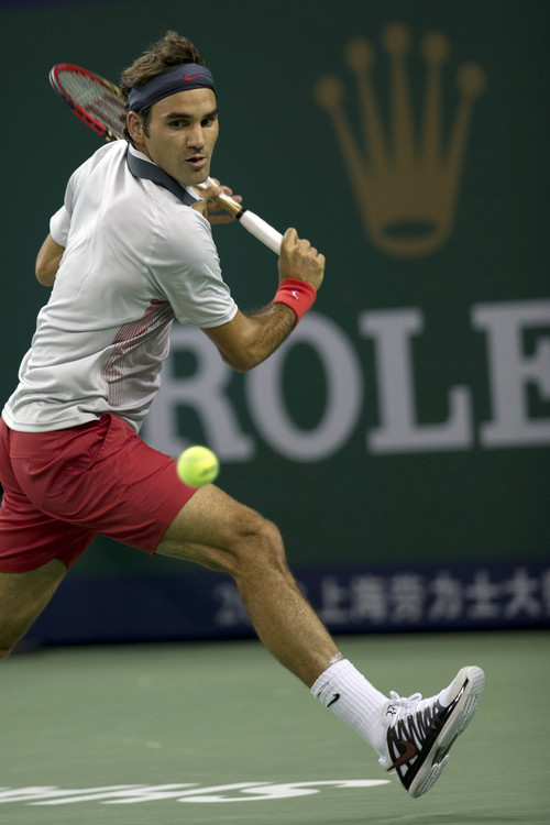 Switzerland's Roger Federer returns a shot from Italy's Andreas Seppi during a match for the Shanghai Masters tennis tournament at the Qizhong Forest Sports City Tennis Center in Shanghai, China, Wednesday Oct 9, 2013. Federer won 6-4, 6-3.(AP Photo/Ng Han Guan)