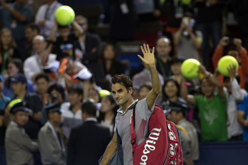 Switzerland's Roger Federer celebrates after winning the match against Italy's Andreas Seppi for the Shanghai Masters tennis tournament at the Qizhong Forest Sports City Tennis Center in Shanghai, China, Wednesday Oct 9, 2013. Federer won 6-4, 6-3. (AP Photo/Ng Han Guan)