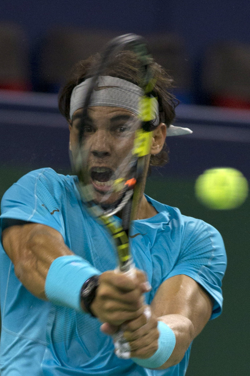 Spain's Rafael Nadal returns a shot from Ukraine's Alexandr Dolgopolov for the Shanghai Masters tennis tournament at the Qizhong Forest Sports City Tennis Center in Shanghai, China, Wednesday, Oct. 9, 2013. Nadal won 6-3, 6-2. (AP Photo/Ng Han Guan)