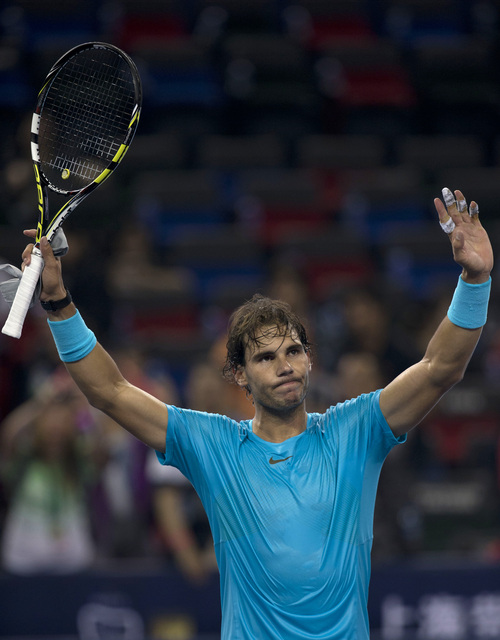 Spain's Rafael Nadal celebrates after defeating Ukraine's Alexandr Dolgopolov during a match for the Shanghai Masters tennis tournament at the Qizhong Forest Sports City Tennis Center in Shanghai, China, Wednesday, Oct. 9, 2013. Nadal won 6-3, 6-2. (AP Photo/Ng Han Guan)