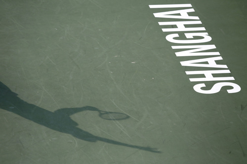 The shadow of Jo-Wilfried Tsonga of France is cast on the court as he serves to Pablo Andujar of Spain during their singles match of the Shanghai Masters tennis tournament at Qizhong Forest Sports City Tennis Center, in Shanghai, China, Wednesday, Oct. 9, 2013. (AP Photo/Eugene Hoshiko)