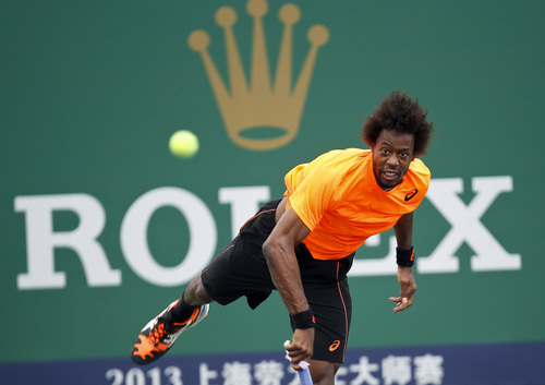 Gael Monfils of France serves against Vasek Pospisil of Canada during their match at the Shanghai Masters tennis tournament at Qizhong Forest Sports City Tennis Center in Shanghai, China Wednesday, Oct. 9, 2013. (AP Photo)