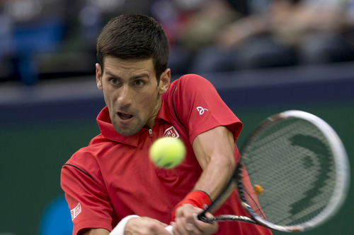 Serbia's Novak Djokovic returns a shot to Spain's Marcel Granollers during their match at the Shanghai Masters tennis tournament at the Qizhong Forest Sports City Tennis Center in Shanghai, China, Wednesday, Oct. 9, 2013. Djokovic won 6-2, 6-0. (AP Photo/Ng Han Guan)