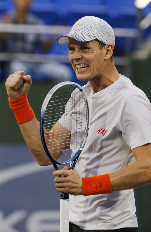 Tomas Berdych of the Czech Republic celebrates after defeating Feliciano Lopez of Spain in their singles match at the Shanghai Masters tennis tournament at Qizhong Forest Sports City Tennis Center, in Shanghai, China, Wednesday, Oct. 9, 2013. Berdych won 7-6, 6-2. (AP Photo/Eugene Hoshiko)