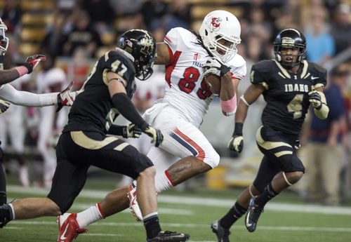 Fresno State's Marcel Jensen (89) cuts between Idaho's Jordan Grabski (47) and Jayshawn Jordan (4) on a 43-yard reception during the first half of an NCAA college football game on Saturday, Oct. 5, 2013, in Moscow, Idaho. Fresno State won 61-14. (AP Photo/Dean Hare)