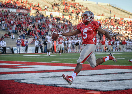New Mexico's running back Kasey Carrier easily trots into the end zone in the opening drive Saturday evening Sept. 28, 2013 at University stadium in Albuquerque, New Mexico. (AP Photo/Albuquerque Journal, Roberto E. Rosales)