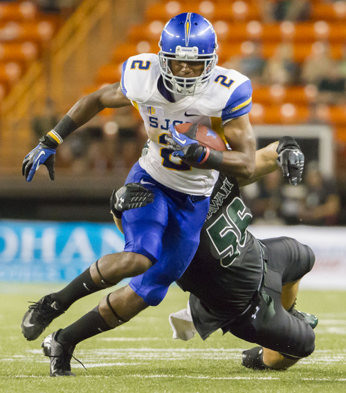 San Jose State wide receiver Tim Crawley (2) attempts to break away from Hawaii linebacker Brenden Daley (56) in the fourth quarter of an NCAA college football game Saturday, Oct. 5, 2013, in Honolulu. San Jose State defeated Hawaii 47-37. (AP Photo/Eugene Tanner)
