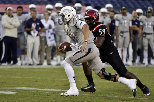 Nevada quarterback Cody Fajardo (17) outruns San Diego State defender Jordan Thomas for a first down during the second quarter of an NCAA college football game on Friday, Oct. 4, 2013, in San Diego. (AP Photo/Lenny Ignelzi)