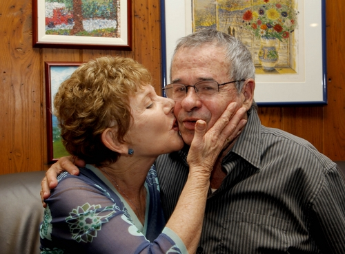 Tami Warshel kisses her husband, University of Southern California Professor of Chemistry and Biochemistry, Arieh Warshel, at his home in Los Angeles, after he was awarded the Nobel Prize in Chemistry, on Wednesday Oct. 9, 2013. Warshel shares the 2013 Nobel Prize in chemistry with Michael Levitt and Martin Karplus for developing powerful computer models that others can use to understand complex chemical interactions and create new drugs. (AP Photo/Nick Ut)