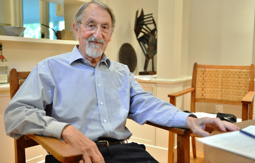 Martin Karplus poses at his home in Cambridge, Mass., after being awarded the Nobel Prize in chemistry Wednesday, Oct. 9, 2013. Karplus, who splits his time between Harvard and the University of Strasbourg, France, is among three awarded the Nobel Prize in chemistry for developing powerful computer models that any researcher can use to understand complex chemical interactions and create new drugs. (AP Photo/Josh Reynolds)