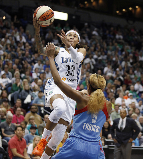 Minnesota Lynx guard Seimone Augustus (33) goes up for a shot against Atlanta Dream guard Jasmine Thomas (5) during the second half of Game 2 of the WNBA basketball finals, Tuesday, Oct. 8, 2013, in Minneapolis. Augustus scored 20 points as the Lynx won 88-63. (AP Photo/Stacy Bengs)