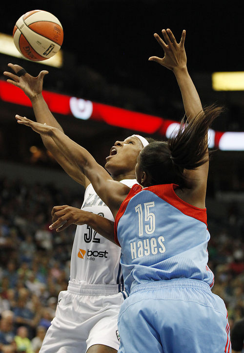Minnesota Lynx forward Rebekkah Brunson (32) goes up to the basket against Atlanta Dream guard Tiffany Hayes (15) during the second half of Game 2 of the WNBA basketball finals, Tuesday, Oct. 8, 2013, in Minneapolis. The Lynx won 88-63. (AP Photo/Stacy Bengs)