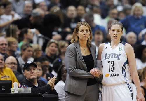 Minnesota Lynx coach Cheryl Reeves clasps hands with guard Lindsay Whalen (13) during the second half of Game 2 of the WNBA basketball finals against the Atlanta Dream, Tuesday, Oct. 8, 2013, in Minneapolis. The Lynx won 88-63. (AP Photo/Stacy Bengs)