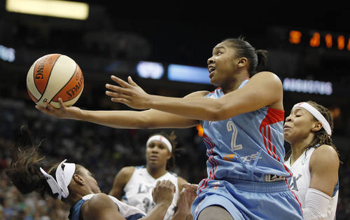 Atlanta Dream guard Alex Bentley (2) knocks down Minnesota Lynx guard Monica Wright, left, and is called for an offensive foul during the first half of Game 2 of the WNBA basketball finals, Tuesday, Oct. 8, 2013, in Minneapolis. The Lynx won 88-63. (AP Photo/Stacy Bengs)