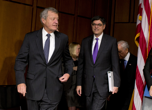 Treasury Secretary Jacob Lew, right, follows Senate Finance Committee Chairman Sen. Max Baucus, D-Mont., on Capitol Hill in Washington, Thursday, Oct. 10, 2013, prior to Lew testifying before the committee. Lew headed to Capitol Hill to both give and get a public scolding. Lew's appearance before the Senate Finance Committee promised to be yet another public restatement of the administration's stance that Congress needs to reopen the government and lift the U.S. borrowing cap before Obama will negotiate over the nation's budget ills.  (AP Photo/ Evan Vucci)