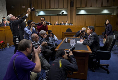 Treasury Secretary Jacob Lew is surrounded by photographers prior to testifying on Capitol Hill in Washington, Thursday, Oct. 10, 2013, before Senate Finance Committee. Lew headed to Capitol Hill to both give and get a public scolding. Lew's appearance before the Senate Finance Committee promised to be yet another public restatement of the administration's stance that Congress needs to reopen the government and lift the U.S. borrowing cap before Obama will negotiate over the nation's budget ills.  (AP Photo/ Evan Vucci)