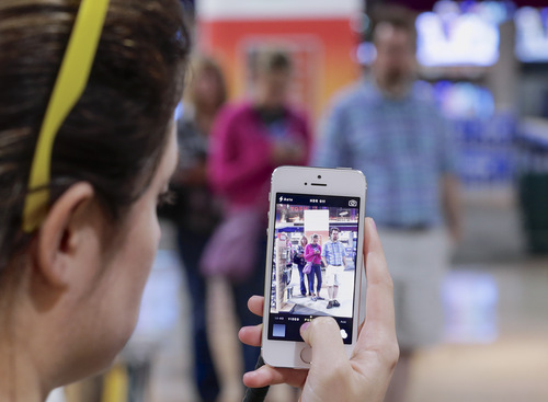 John Ulrich of Omaha waits at the head of the line for a new iPhone 5s at the Nebraska Furniture Mart in Omaha, Neb., on Friday, Sept. 20, 2013, the day the new iPhone 5c and 5s models go on sale. (AP Photo/Nati Harnik)