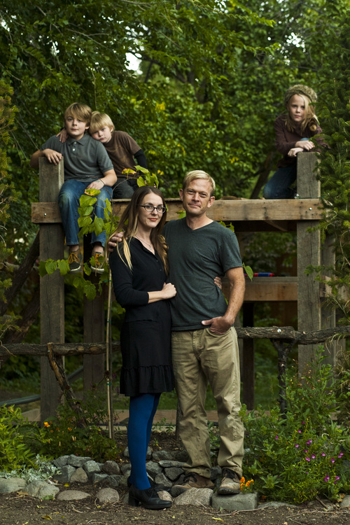 Chris Detrick  |  The Salt Lake Tribune Phil Sherburne and his wife Leia Bell pose for a portrait with their kids Cortez, 11, Oslo, 6, and Ivan, 9, at their home in Salt Lake City Wednesday October 9, 2013. Sherburne and Bell, owners of the frame and art store called Signed & Numbered, succeeded on Oct. 5 in signing up for health coverage on healthcare.gov.